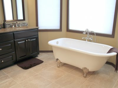 soaker tub and black vanity