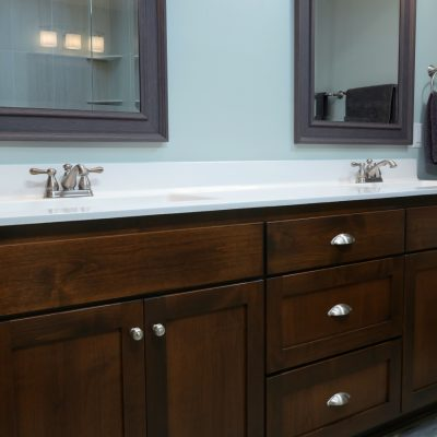 dark stained bathroom vanity with white top