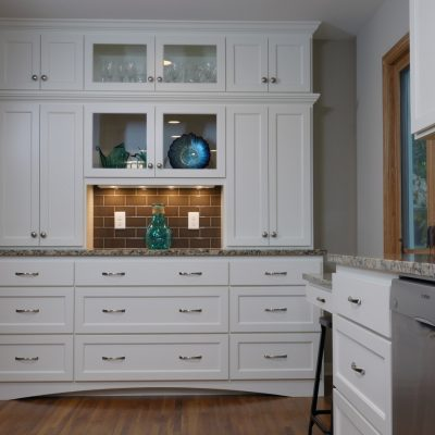white kitchen cabinets and stainless steel appliances