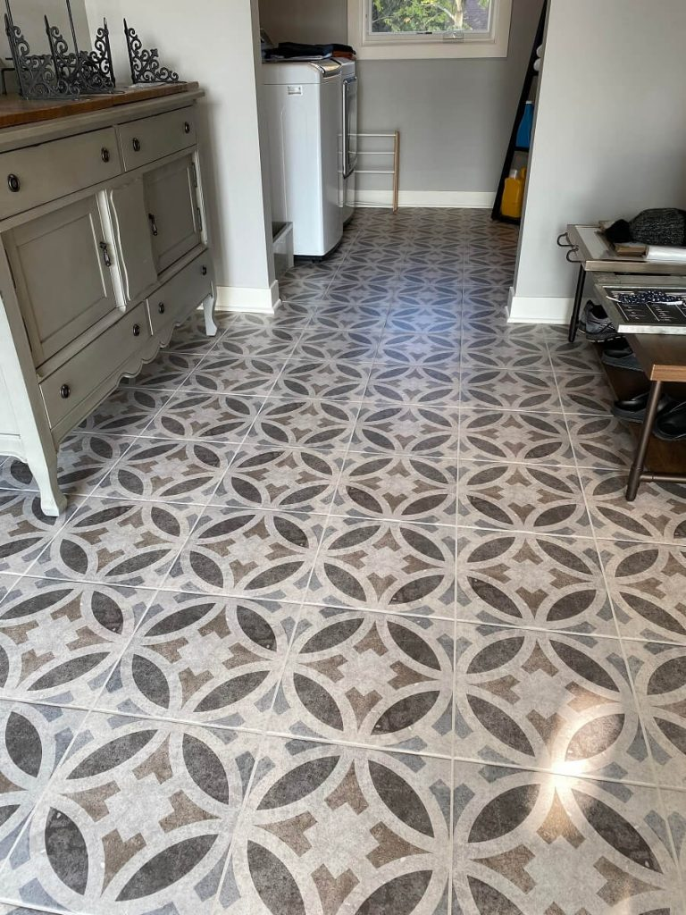 Laundry room with patterned tile floor
