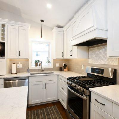 White kitchen cabinets and quartz countertops